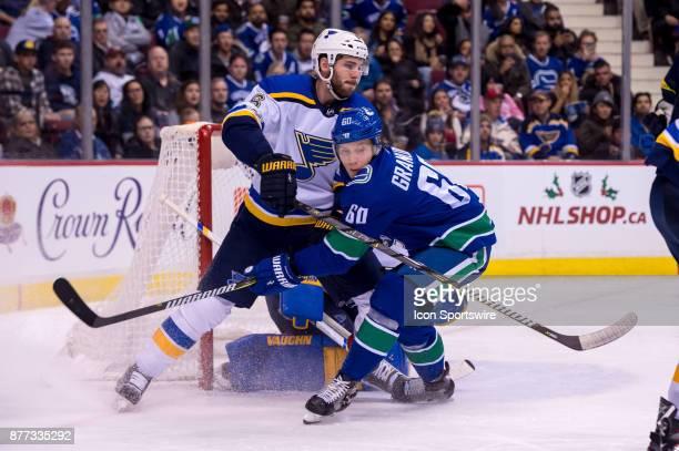 St Louis Blues Defenceman Joel Edmundson defends against Vancouver Canucks Center Markus Granlund during their NHL game at Rogers Arena on November...