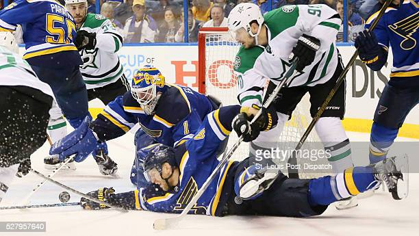 St Louis Blues defenseman Carl Gunnarsson and goaltender Brian Elliott try to defend as the Dallas Stars' Jason Spezza pressures in the second period...