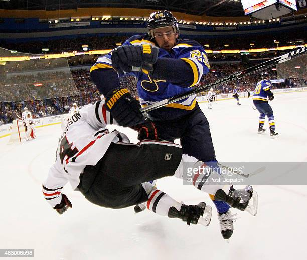 St Louis Blues defenseman Chris Butler knocks down Chicago Blackhawks defenseman Niklas Hjalmarsson during first period action on Sunday Feb 8 at the...