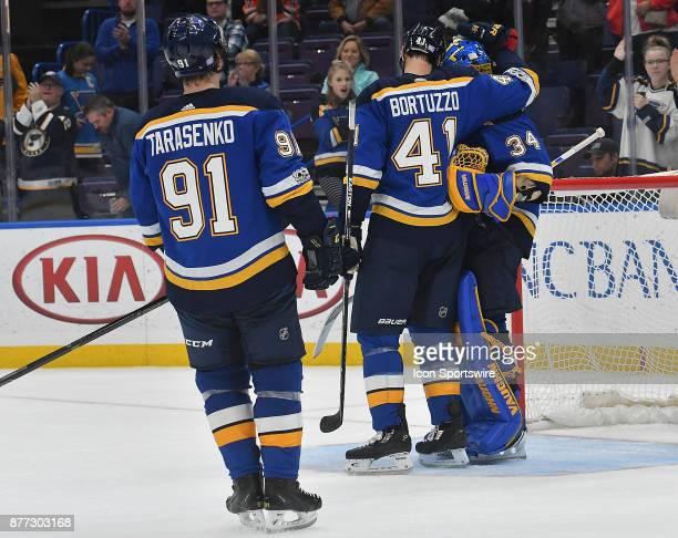 St Louis Blues defenseman Robert Bortuzzo and St Louis Blues right wing Vladimir Tarasenko congratulate St Louis Blues goalie Jake Allen after...