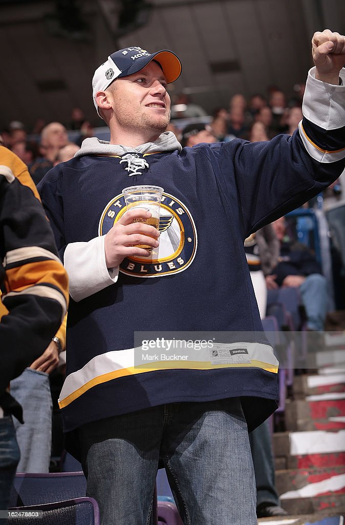 A St. Louis Blues fan cheers on his team in an NHL game between the St. Louis Blues and the Columbus Blue Jackets on February 23, 2013 at Scottrade Center in St. Louis, Missouri.