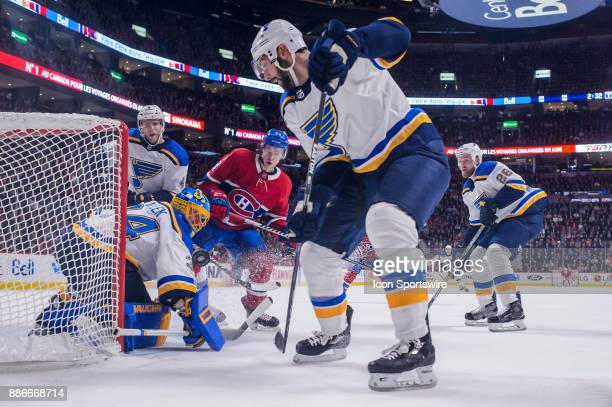 St Louis Blues goalie Jake Allen makes a blocker save on Montreal Canadiens left wing Charles Hudon during the first period of the NHL game between...
