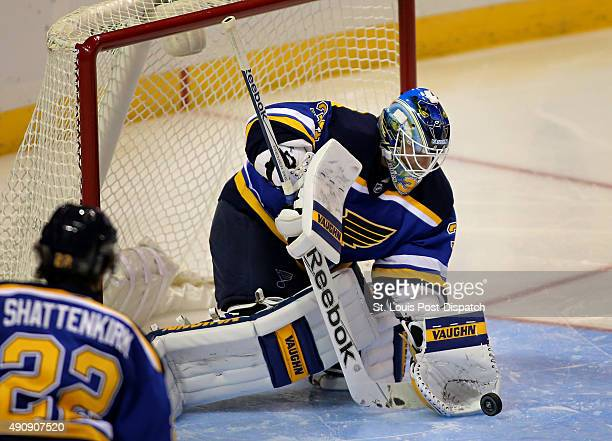 St Louis Blues goalie Jake Allen scoops up a shot in the second period against the Chicago Blackhawks in preseason action at the Scottrade Center in...