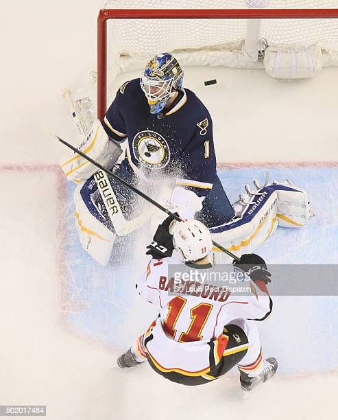 St Louis Blues goaltender Brian Elliott is unable to stop a goal by Calgary Flames defenseman Mark Giordano not pictured in the third period on...