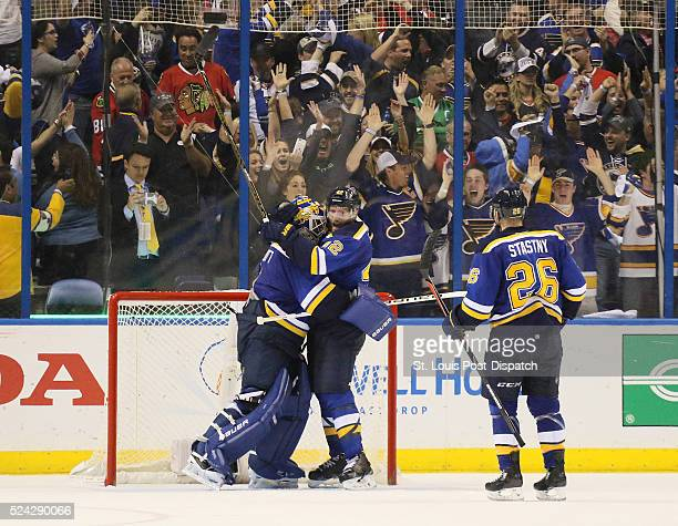St Louis Blues goaltender Brian Elliott left celebrates with center David Backes as time expires on Monday April 25 at the Scottrade Center in St...