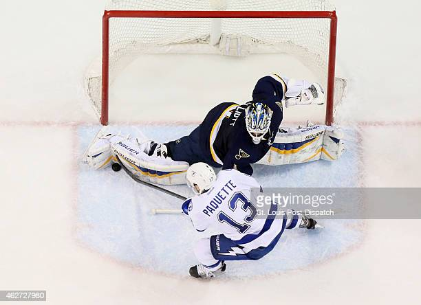 St Louis Blues goaltender Brian Elliott makes a save against the Tampa Bay Lightning's Cedric Paquette in the third period on Tuesday Feb 3 at the...
