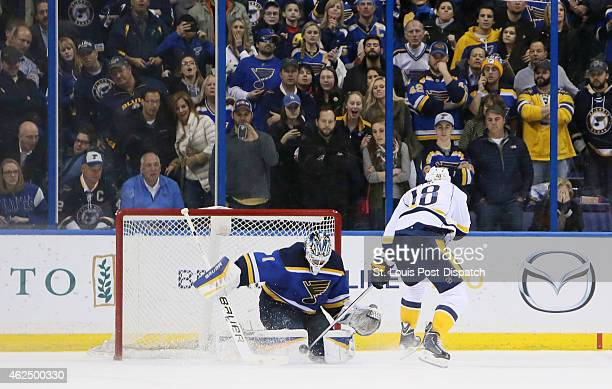 St Louis Blues goaltender Brian Elliott makes a save against the Nashville Predators' James Neal to seal a 54 win in the shootout on Thursday Jan 29...