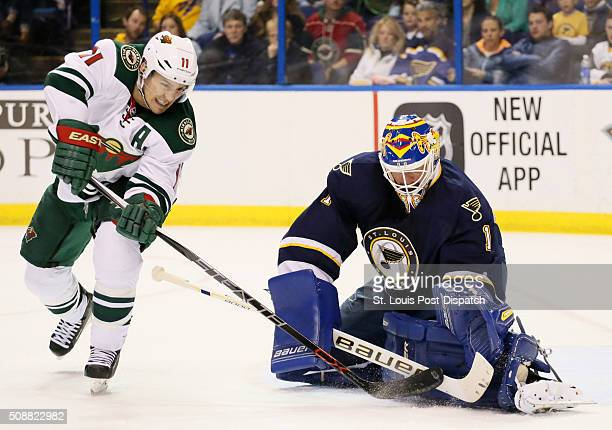 St Louis Blues goaltender Brian Elliott right defends against Minnesota Wild left wing Zach Parise during the second period on Saturday Feb 6 at the...