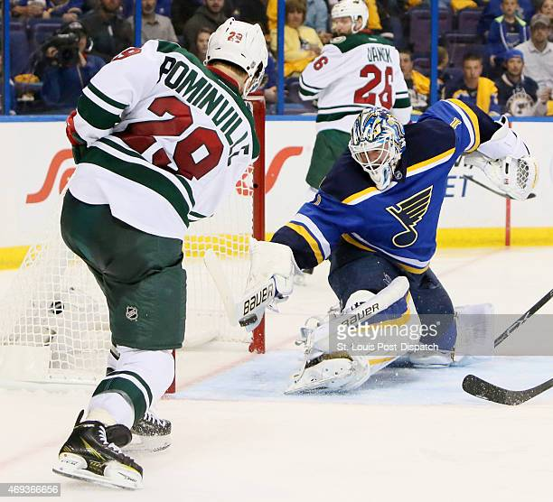St Louis Blues goaltender Brian Elliott right stops a shot by the Minnesota Wild's Jason Pominville left in the second period on Saturday April 11 at...