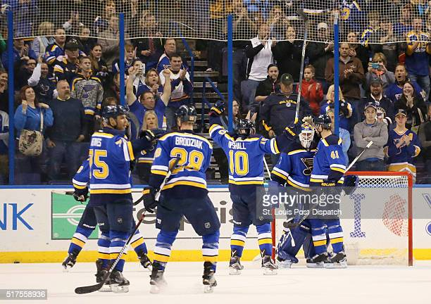 St Louis Blues goaltender Brian Elliott second from right is congratulated by teammates Robert Bortuzzo right and Scottie Upshall after shutting out...