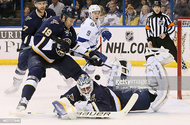 St Louis Blues goaltender Brian Elliott tries to make a save as Jay Bouwmeester helps defend in the second period against the Tampa Bay Lightning on...