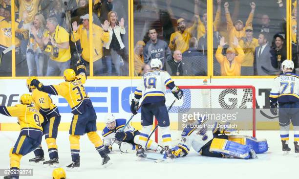 St Louis Blues goaltender Jake Allen reacts after the Nashville Predators' Ryan Ellis not pictured scored the first goal of the game in the third...