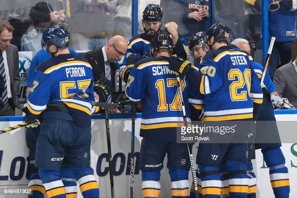 St Louis Blues head coach Mike Yeo goes over a play during a timeout against the Edmonton Oilers on February 28 2017 at Scottrade Center in St Louis...