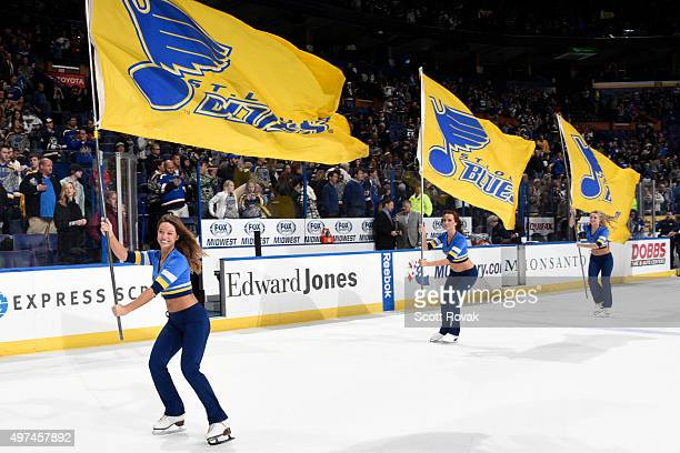 St Louis Blues ice crew skate with flags after the Blues defeated the Winnipeg Jets 32 on November 16 2015 at Scottrade Center in St Louis Missouri