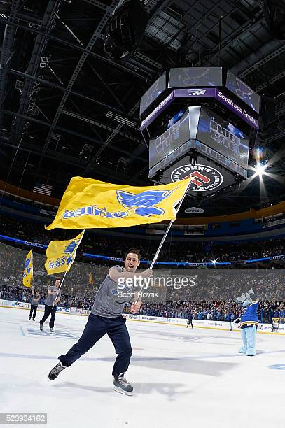 St Louis Blues ice crew skate with flags after the Blues defeated the Chicago Blackhawks in Game One of the Western Conference First Round during the...