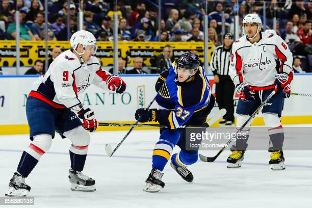 St Louis Blues left wing Klim Kostin right takes a shot on goal past Washington Capitals defenseman Dmitry Orlov left during the first period of an...