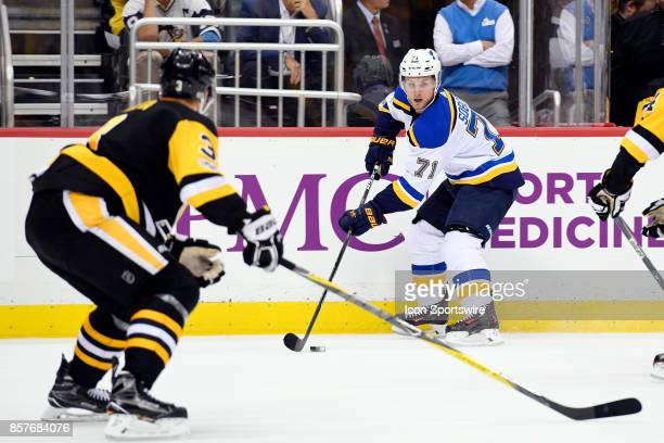 St Louis Blues Left Wing Vladimir Sobotka skates with the puck as Pittsburgh Penguins Defenceman Olli Maatta defends during the third period in the...