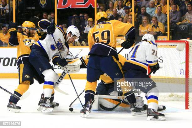 St Louis Blues left wing Zach Sanford challenges Nashville Predators goalie Pekka Rinne for the puck as Nashville Predators defenseman Ryan Ellis and...