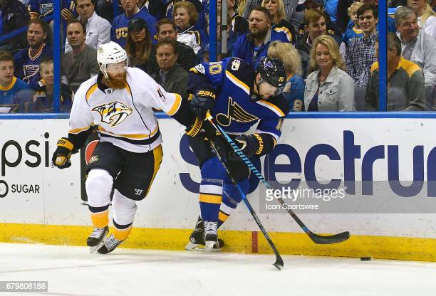 St Louis Blues leftwing Scottie Upshall gets control of the puck as Nashville defenseman Ryan Ellis defends during game five of the second round of...