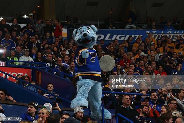 St Louis Blues mascot Louie stands with the fans during a game between the St Louis Blues and the Toronto Maple Leafsat the Scottrade Center on...
