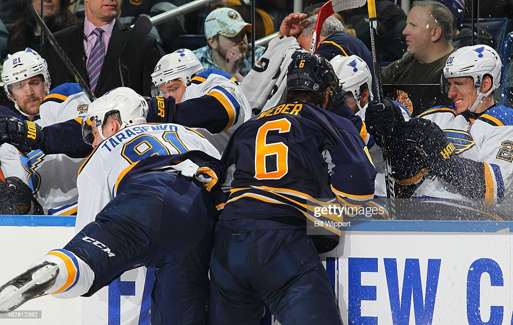 St. Louis Blues players react from the bench as teammate <a gi-track='captionPersonalityLinkClicked' href=/galleries/search?phrase=Vladimir+Tarasenko&family=editorial&specificpeople=6142635 ng-click='$event.stopPropagation()'>Vladimir Tarasenko</a> #91 collides with <a gi-track='captionPersonalityLinkClicked' href=/galleries/search?phrase=Mike+Weber+-+Ice+Hockey+Player&family=editorial&specificpeople=10833386 ng-click='$event.stopPropagation()'>Mike Weber</a> #6 of the Buffalo Sabres on February 5, 2015 at the First Niagara Center in Buffalo, New York.