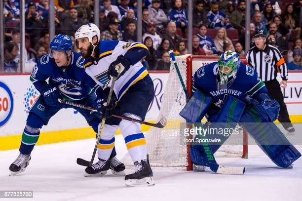 St Louis Blues Right Wing Chris Thorburn and Center Bo Horvat battle for position in front of Vancouver Canucks Goalie Anders Nilsson during their...