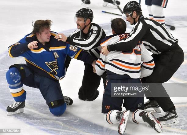 St Louis Blues right wing Vladimir Tarasenko and Edmonton Oilers defenseman Matt Benning fight during a NHL hockey game between the Edmonton Oilers...