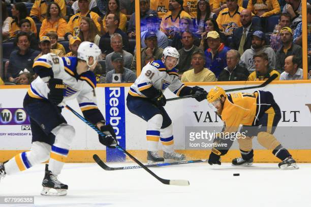 St Louis Blues right wing Vladimir Tarasenko makes a pass beneath the stick of Nashville Predators defenseman Ryan Ellis during Game Four of Round...