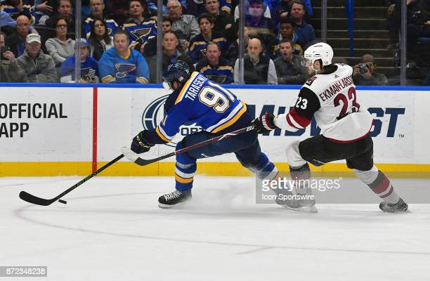 St Louis Blues right wing Vladimir Tarasenko skates ahead of Arizona Coyotes defenseman Oliver EkmanLarsson during a National Hockey League game...