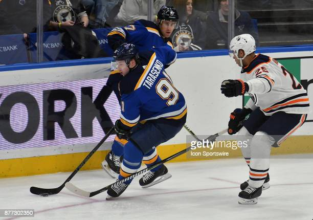 St Louis Blues right wing Vladimir Tarasenko skates with the puck ahead of Edmonton Oilers defenseman Darnell Nurse during a NHL hockey game between...