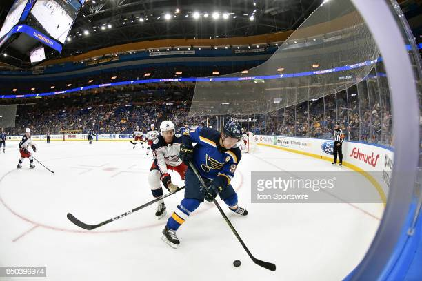 St Louis Blues right wing Vladimir Tarasenko with the pic defended by Columbus Blue Jackets center Zac Dale during a preseason National Hockey League...