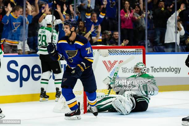St Louis Blues' Vladimir Sobotka left celebrates a goal by St Louis Blues' Carl Gunnarsson as Dallas Stars goalie Kari Lehtonen right lays on the ice...
