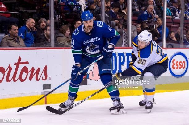 St Louis Blues Winger Alexander Steen stick checks Vancouver Canucks Defenceman Erik Gudbranson during their NHL game at Rogers Arena on November 18...