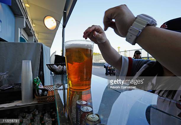 St Louis Cardinal fan purchases beer at Dodger Stadium prior to the start of the baseball game between the St Louis Cardinals and Los Angeles Dodgers...