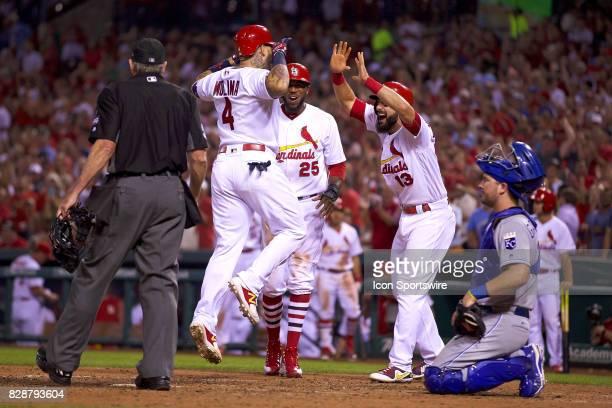St Louis Cardinals catcher Yadier Molina is congratulated by St Louis Cardinals first baseman Matt Carpenter after hitting a grand slam in the bottom...