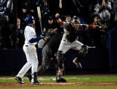 St Louis Cardinals' catcher Yadier Molina rejoices after New York Mets' Carlos Beltran strikes out looking in the ninth inning to end Game 7 of the...