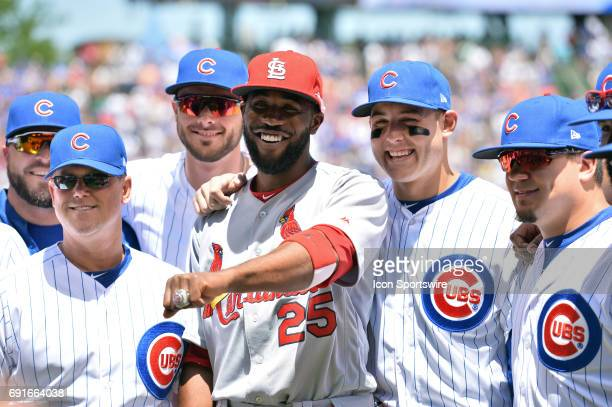 St Louis Cardinals Center field Dexter Fowler is presented with his World Series ring before the game between the St Louis Cardinals and the Chicago...
