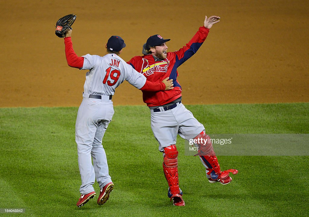 St. Louis Cardinals center fielder Jon Jay (19), left, celebrates with a teammate after the Washington Nationals defeated the St. Louis Cardinals, 9-7, in Game 5 of the National League Division Series at Nationals Park in Washington, D.C., Friday, October 12, 2012.