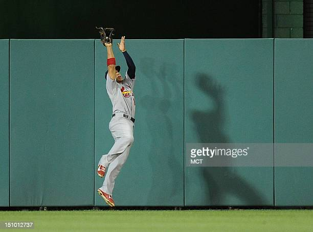 St Louis Cardinals center fielder Jon Jay makes a leaping catch on a ball hit to deep centerfield by the Washington Nationals' Bryce Harper in the...