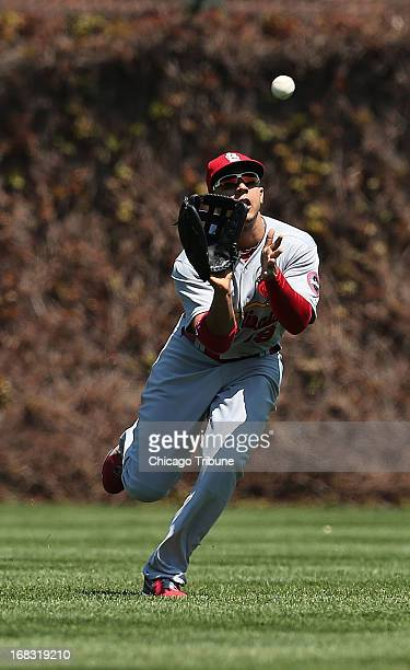 St Louis Cardinals center fielder Jon Jay makes a running catch of a sinking fly ball off the bat of the Chicago Cubs' Starlin Castro in the first...