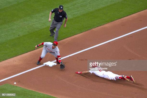 St Louis Cardinals center fielder Tommy Pham slides to third base ahead of the tag against Cincinnati Reds third baseman Eugenio Suarez during a MLB...