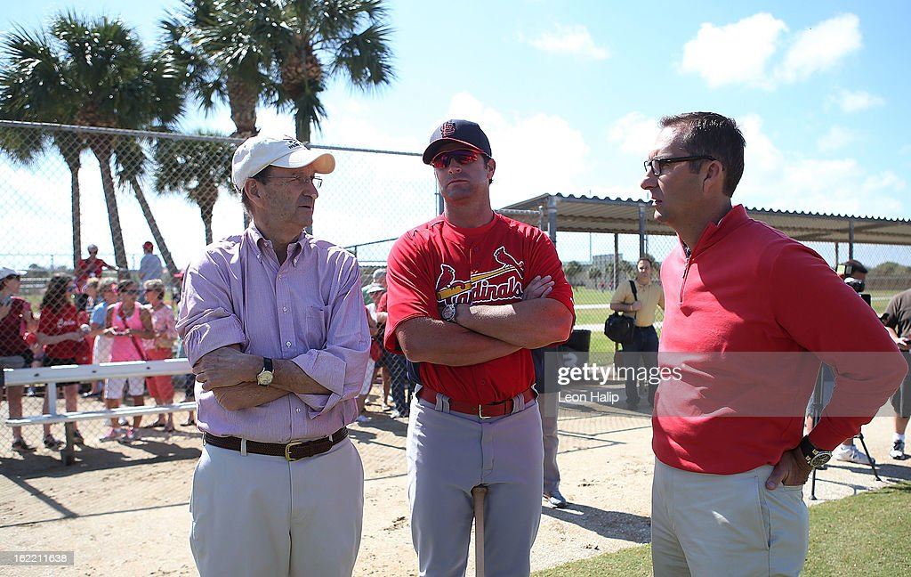 St. Louis Cardinals Chairman and Chief Executive Officer William O. DeWitt Jr. Manager Mike Matheny #22 and Sr. Vice President and General Manager John Mozeliak watch the action during spring training on February 20, 2013 in Jupiter, Florida.