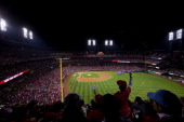 St Louis Cardinals fans cheer during Game 5 of the 2013 World Series against the Boston Red Sox at Busch Stadium on Monday October 28 2013 in St...