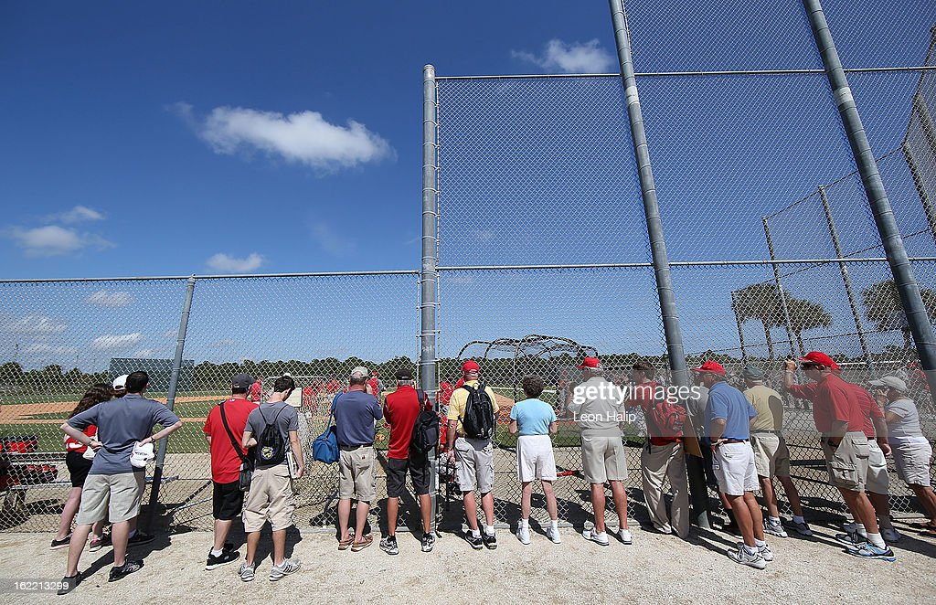 St. Louis Cardinals fans line the fences to watch the action during spring training on February 20, 2013 in Jupiter, Florida.