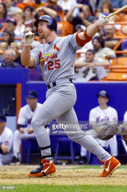 St Louis Cardinals first baseman Mark McGwire watches his 50th home run of the year clear the fence at Shea Stadium in New York City August 22 1999...