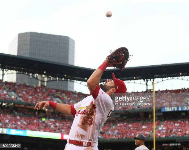 St Louis Cardinals first baseman Matt Carpenter catches a popup in foul territory by the Pittsburgh Pirates' Gregory Polanco to end the top of the...