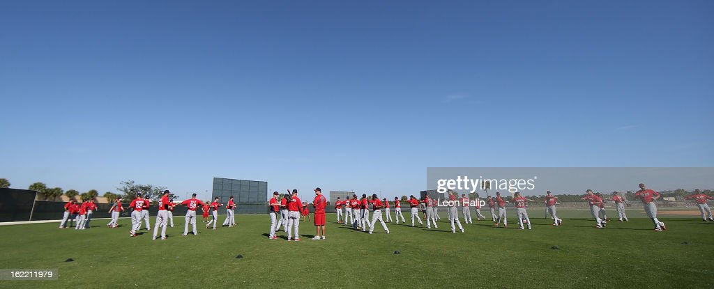St. Louis Cardinals goes through the morning stretching drills during spring training on February 20, 2013 in Jupiter, Florida.