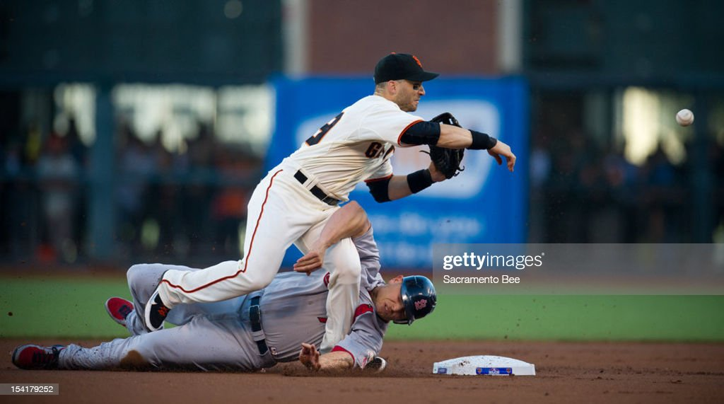 St. Louis Cardinals left fielder Matt Holliday (7) slides hard into San Francisco Giants second baseman Marco Scutaro (19) in the first inning during Game 2 of the National League Championship Series on Monday, October 15, 2012, at AT&T Park in San Francisco, California.