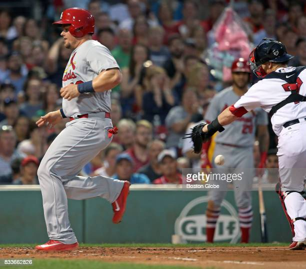 St Louis Cardinals' Luke Voit scores in the top of the fourth inning as Red Sox catcher Christian Vazquez drops the throw to the plate He was charged...