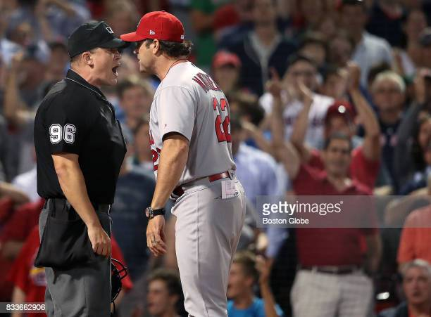 St Louis Cardinals manager Mike Matheny right and home plate umpire Chris Segal go head to head during a bottom of the ninth inning argument Matheny...